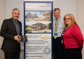 DisabledGo Chairman presents a plaque to the Chairman and Deputy Chief Nurse at North West Anglia NHS Foundation Trust