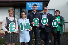 Jeremy presents the funds raised to the Woodlands and Macmillan