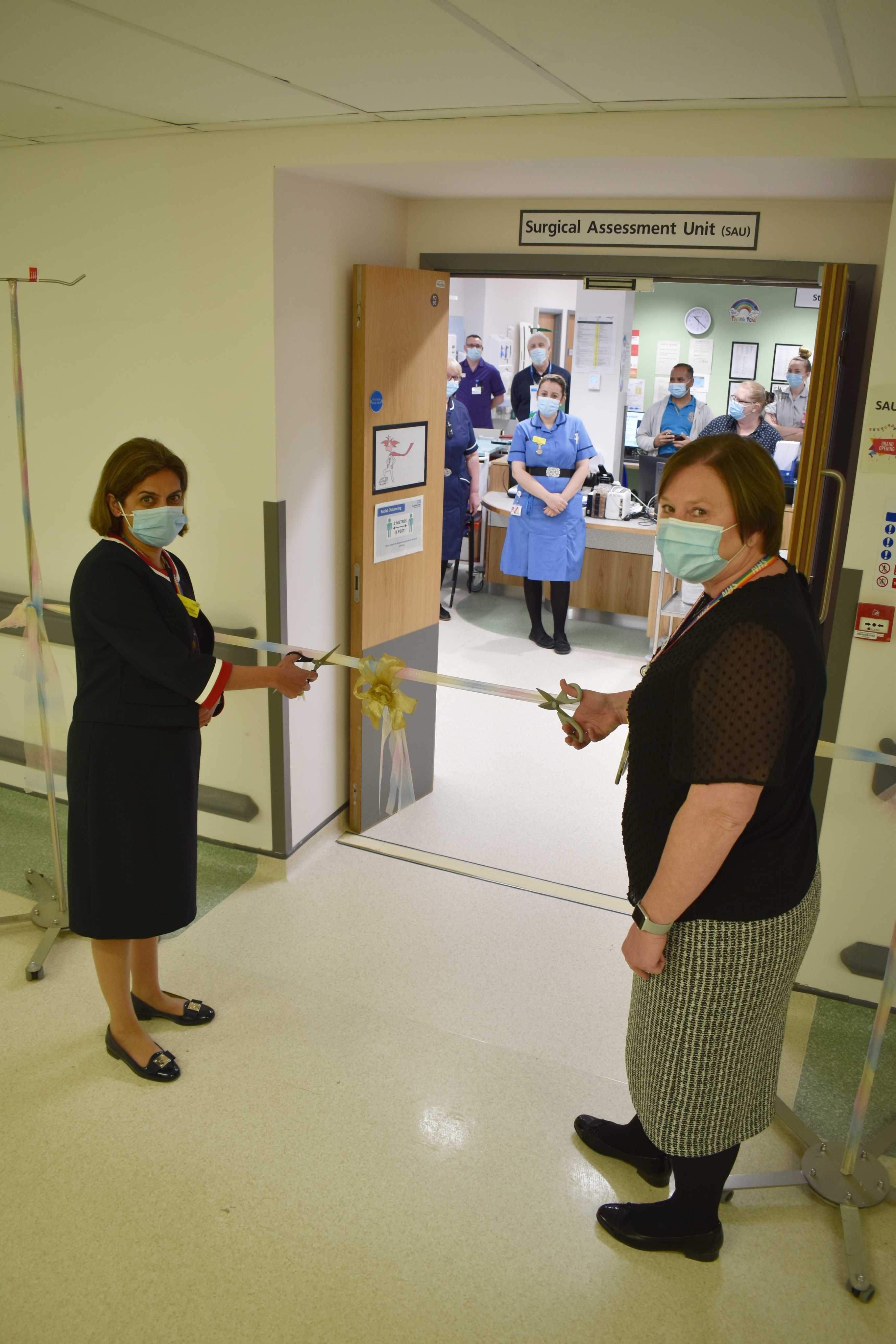 Chief Medical Officer, Kanchan Rege and Chief Nurse Jo Bennis cutting ribbon.jpg