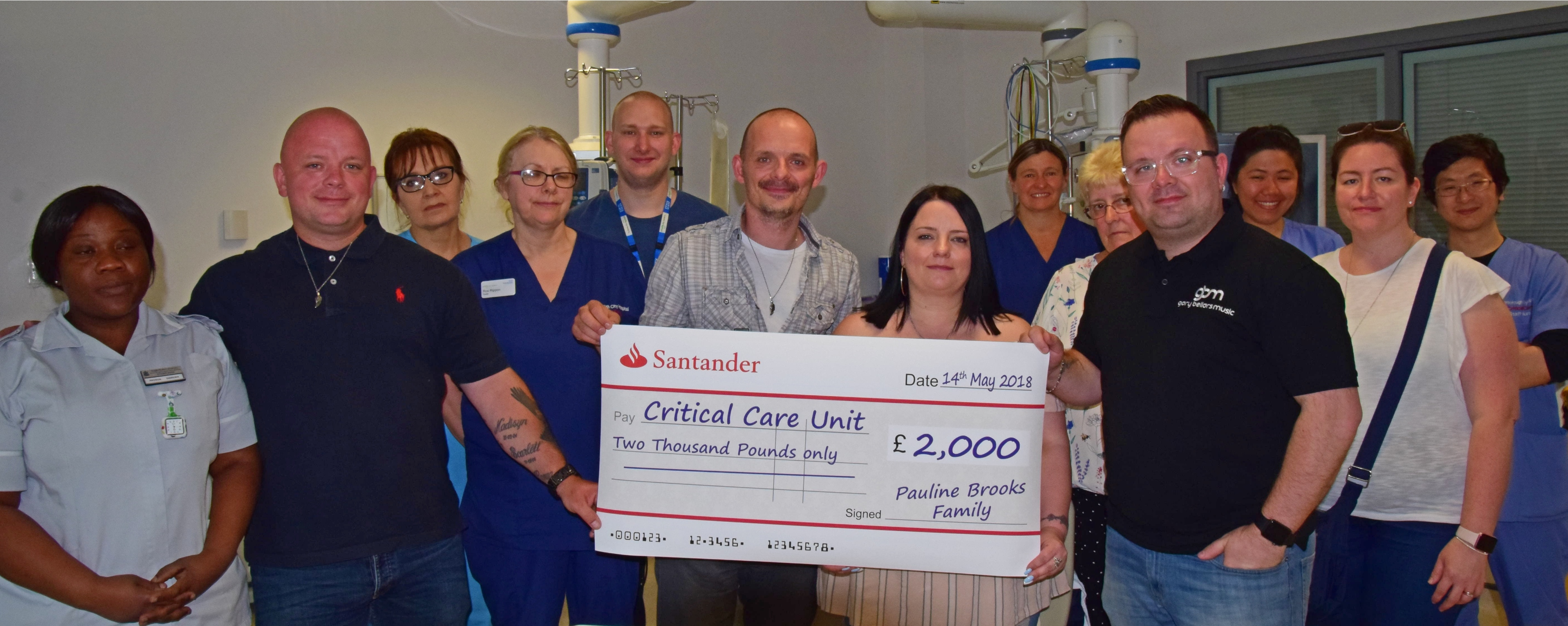 Family present cheque to staff on Critical Care